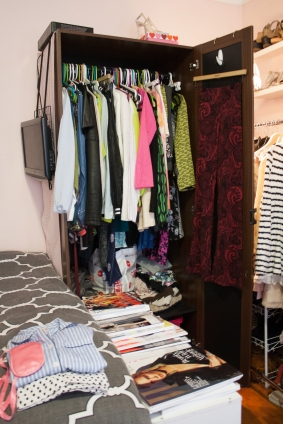 Anything that isn't pink, black, gold or white I store inside my wardrobe because it doesn't match my room.