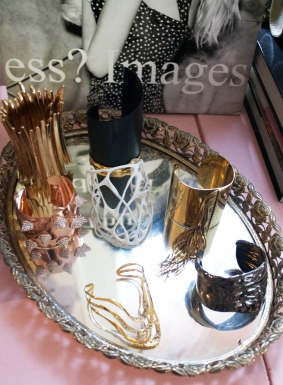 I display my favorite pieces on my mirrored trays. It stores my pieces and decorates my room at the same time.